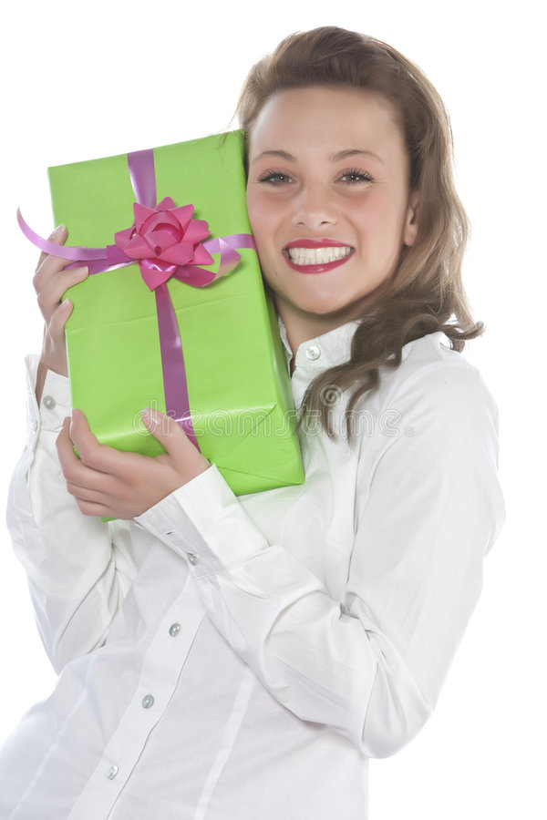 Giovane ragazza sorridente con il presente fotografie stock libere da diritti