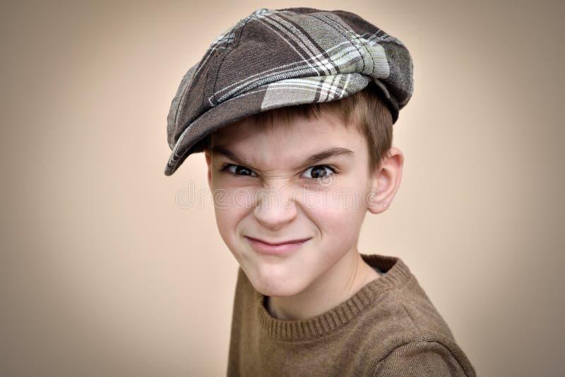Giovane ragazzo arrabbiato fotografia stock libera da diritti