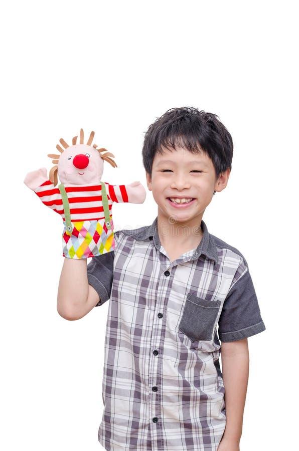 Giovane ragazzo che gioca con il burattino fotografie stock