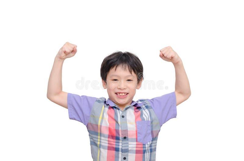 Giovane ragazzo che mostra il suo potere immagini stock