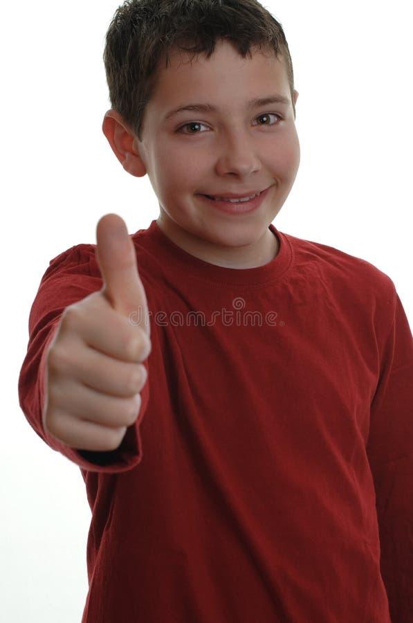 Giovane ragazzo con il pollice su 1