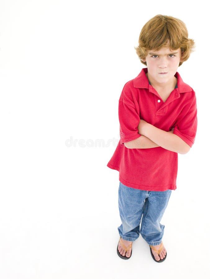 Giovane ragazzo con le braccia immagini stock libere da diritti
