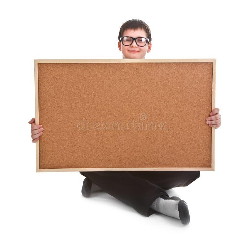 Giovane ragazzo ed albo vuoto fotografia stock libera da diritti