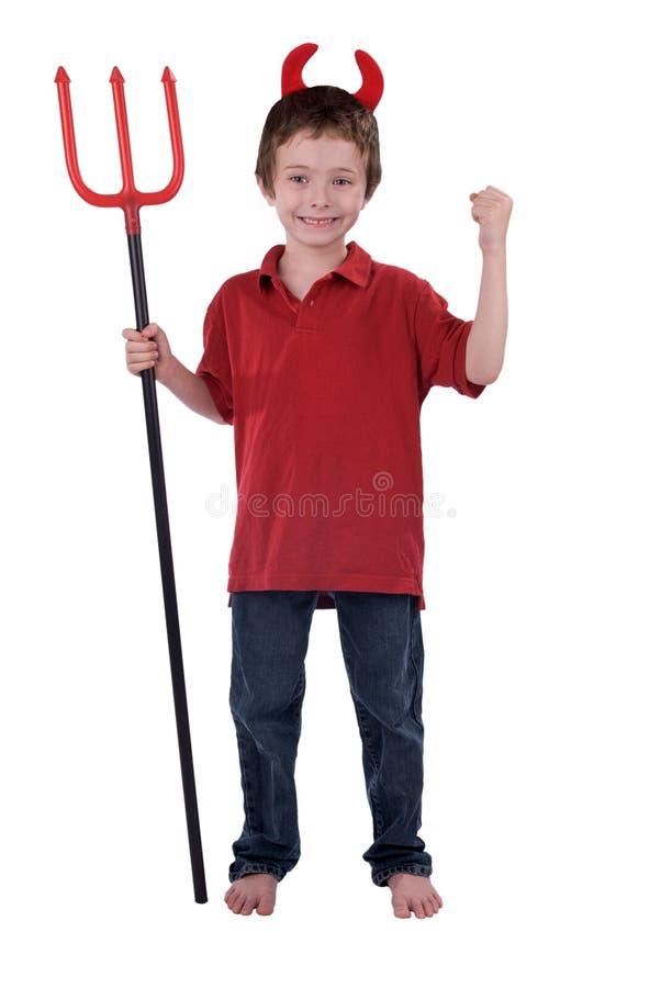 Giovane ragazzo in un costume del diavolo fotografie stock