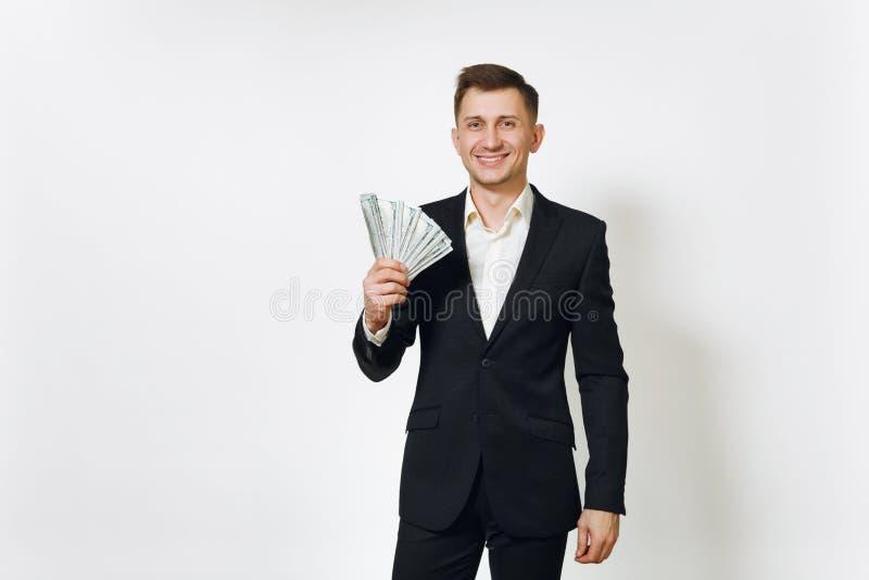 Giovane riuscito uomo ricco bello di affari in vestito nero su fondo bianco per annunciare immagine stock libera da diritti