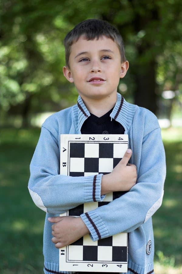 Giovane scacchi-giocatore fotografia stock libera da diritti