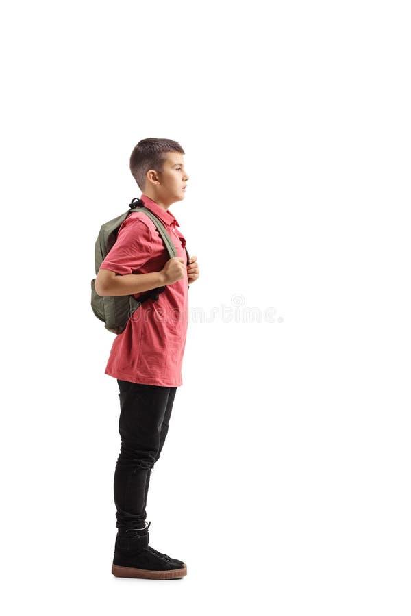 Giovane scolaro che aspetta nella linea immagine stock libera da diritti