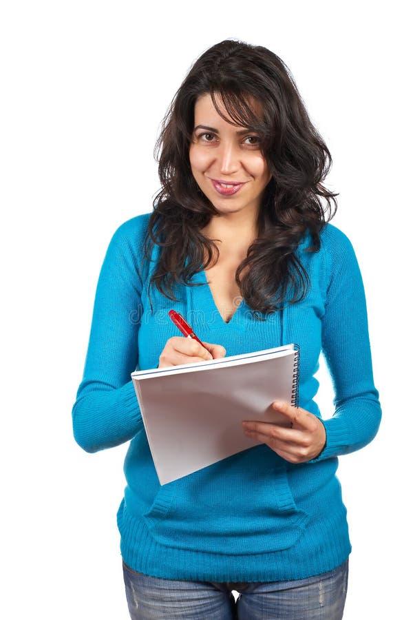 Giovane scrittura della donna dell'allievo immagine stock libera da diritti