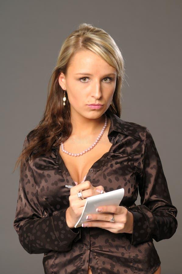 Giovane segretaria attraente fotografia stock