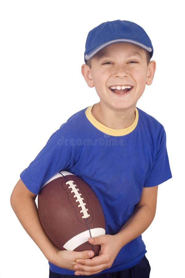 Giovane sfera di rugby e del ragazzo immagine stock