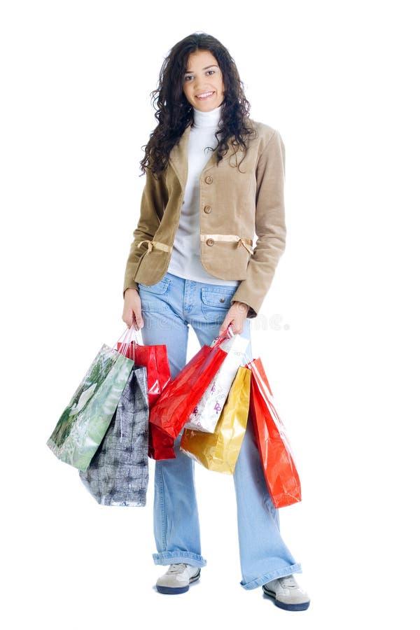 Giovane signora attraente con i sacchetti di acquisto immagini stock libere da diritti