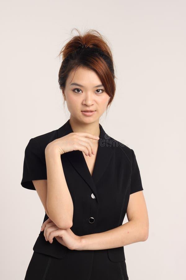 Giovane signora cinese in abbigliamento convenzionale immagine stock