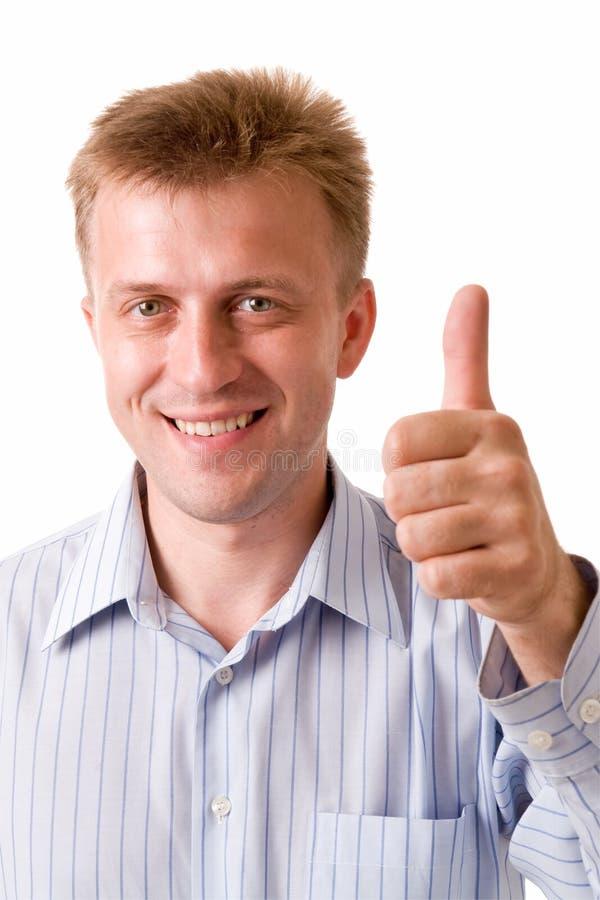 Giovane sorridente con i pollici in su fotografia stock