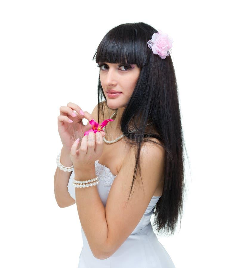 Giovane sposa con il fiore immagine stock