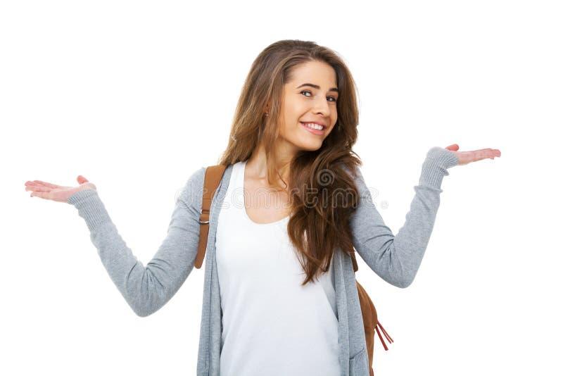 Giovane studente felice che scrolla le spalle in dubbio - isolato fotografia stock libera da diritti