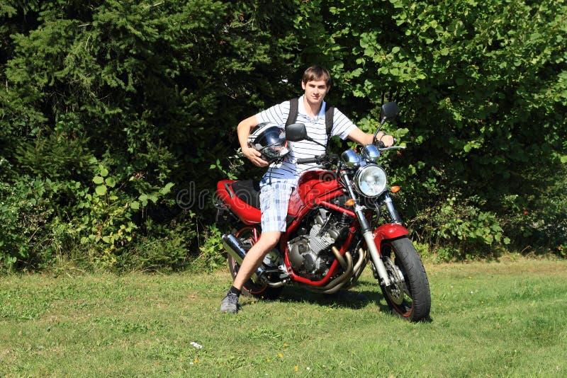 Giovane sulla motocicletta fotografia stock