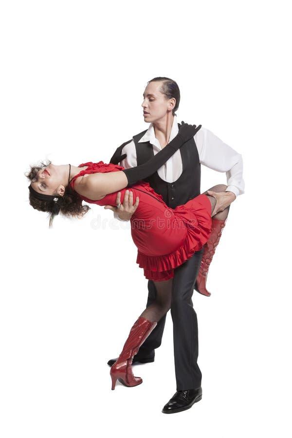 Giovane tango di dancing delle coppie immagine stock