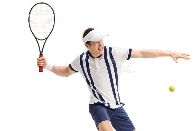 Giovane tennis che colpisce un ritorno fotografia stock libera da diritti