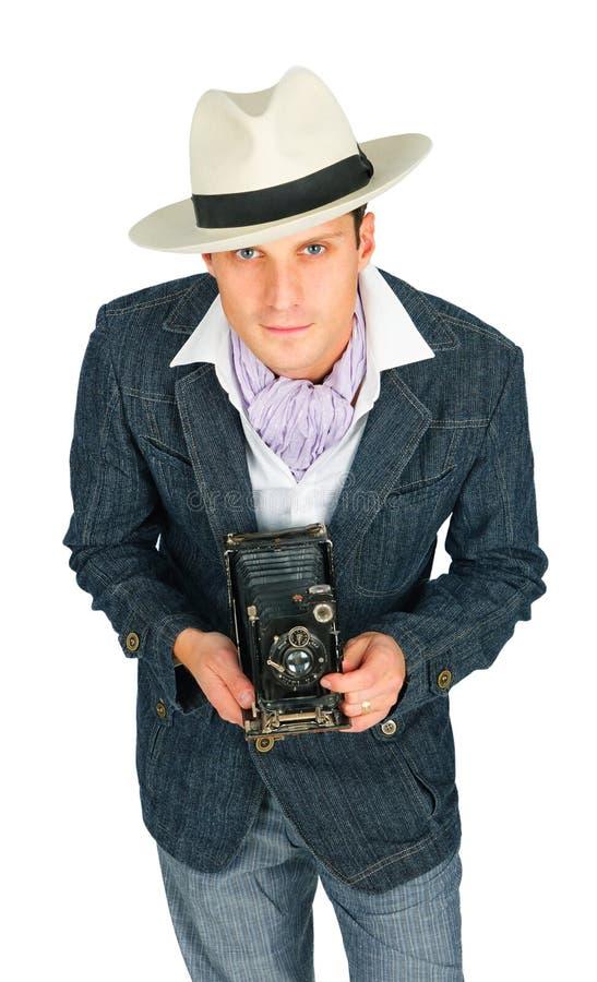 Giovane in un retro stile con una macchina fotografica immagine stock libera da diritti