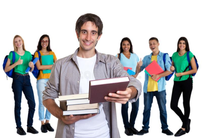 Giovane uomo adulto turco felice con altri studenti immagini stock libere da diritti