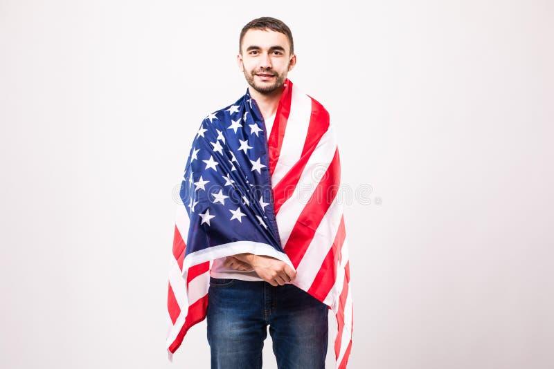 Giovane uomo bello con la bandiera americana immagine stock libera da diritti
