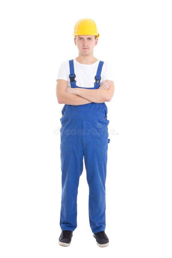 Giovane uomo bello in uniforme blu del costruttore isolata su bianco fotografia stock libera da diritti