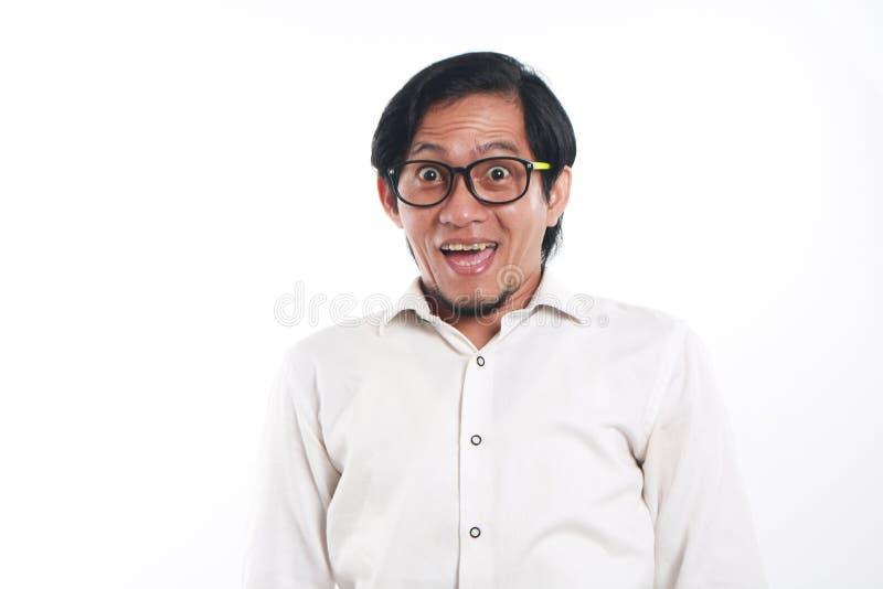 Giovane uomo d'affari asiatico divertente felice fotografie stock