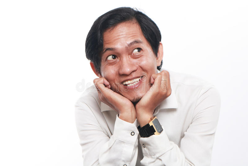 Giovane uomo d'affari asiatico felice Thinking immagini stock libere da diritti