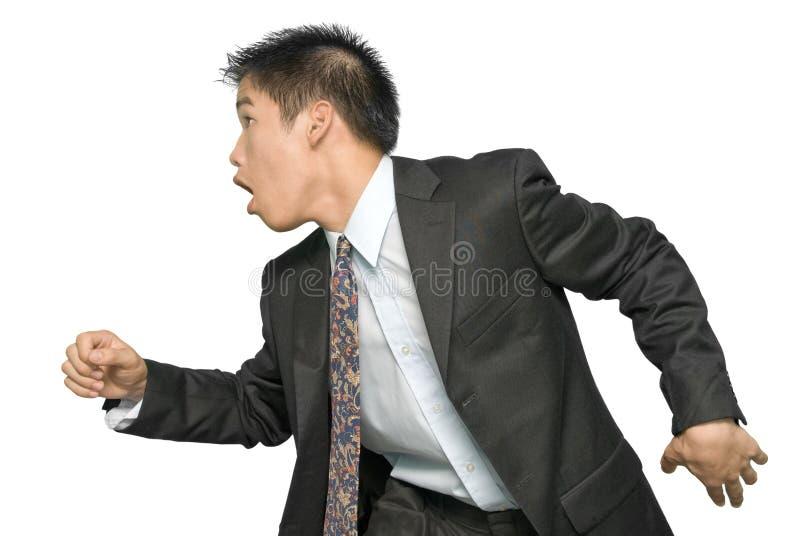 Giovane uomo d'affari asiatico scorrente veloce fotografie stock libere da diritti
