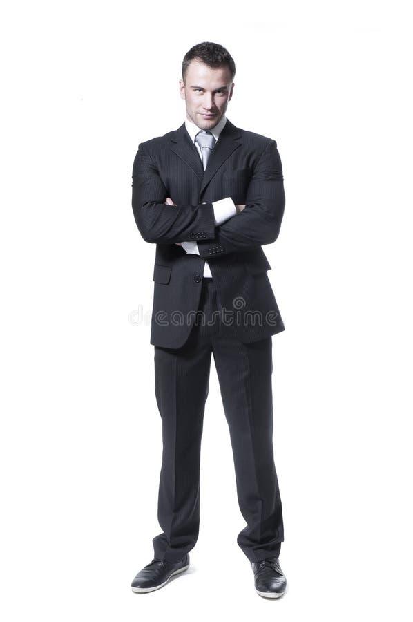Giovane uomo d'affari astuto in vestito nero immagine stock