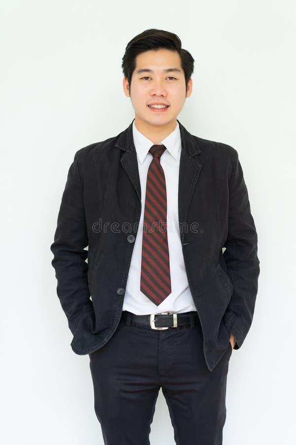 Giovane uomo d'affari bello asiatico felice immagini stock libere da diritti