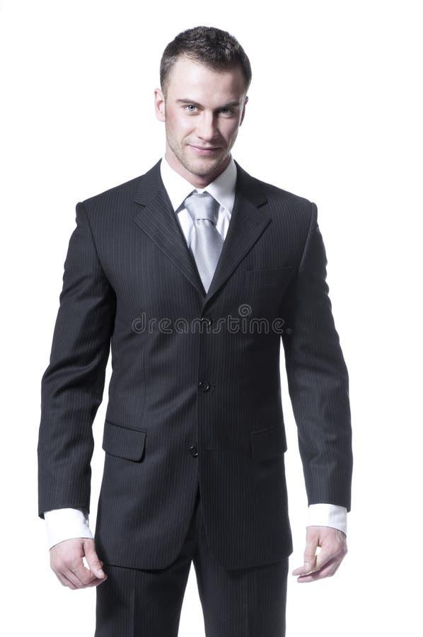 Giovane uomo d'affari bello in vestito nero fotografie stock