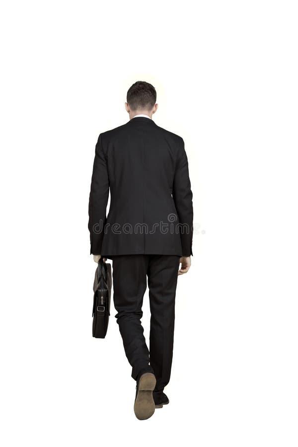 Giovane uomo d'affari che cammina sullo studio fotografie stock libere da diritti