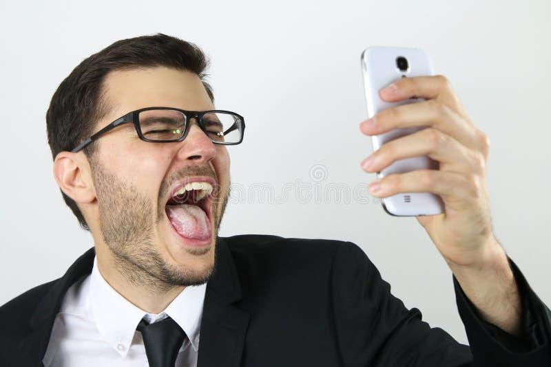 Download Giovane Uomo D'affari Che Fa Un Selfie Immagine Stock - Immagine di divertimento, gridare: 55363061