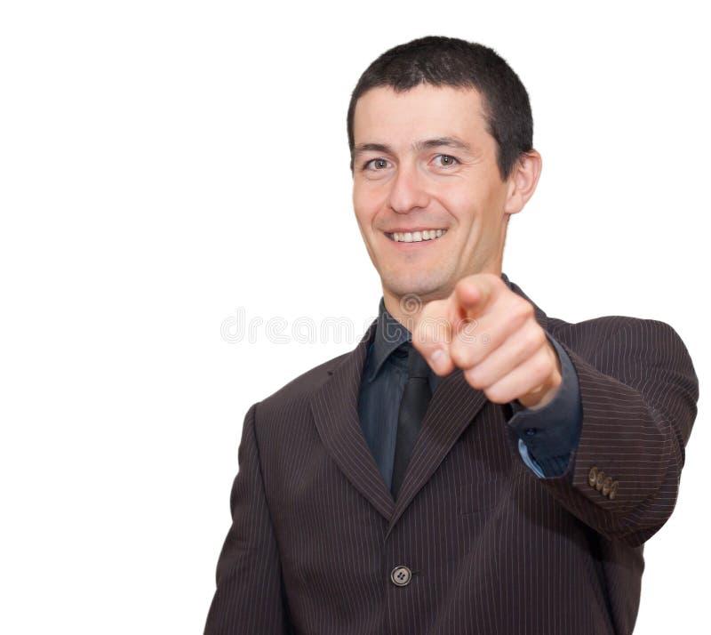 Giovane uomo d'affari che sorride e che indica fotografia stock