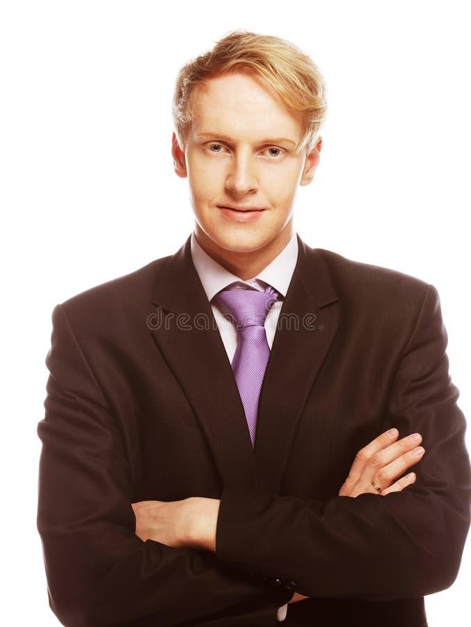Giovane uomo d'affari che sta con le sue mani immagine stock libera da diritti