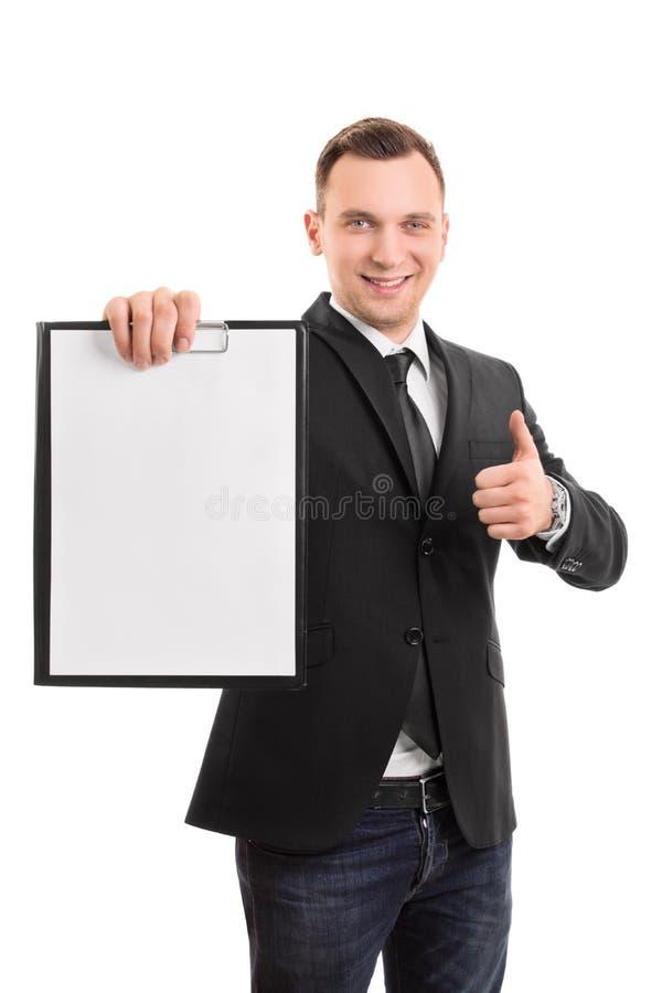 Giovane uomo d'affari che tiene i appunti fotografie stock libere da diritti