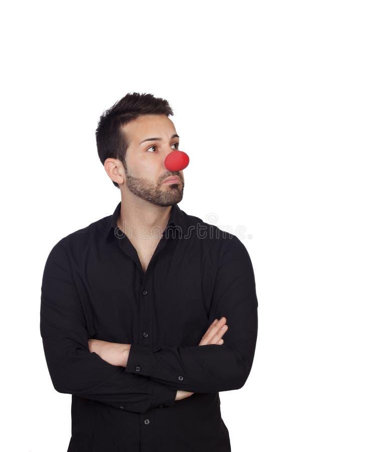 Giovane uomo d'affari con il naso del pagliaccio fotografie stock