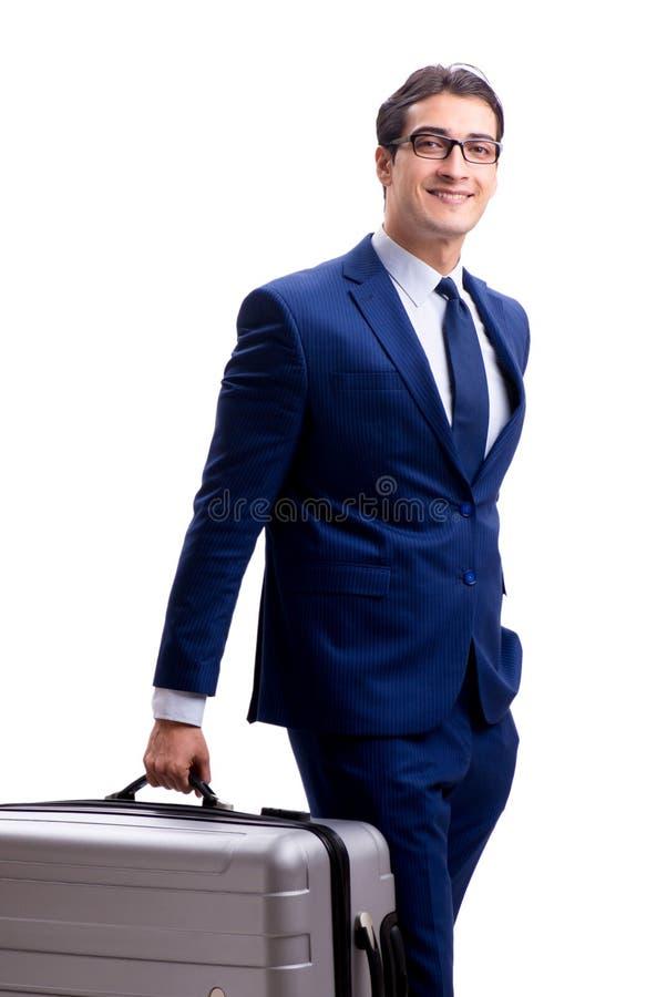 Giovane uomo d'affari con la valigia isolata su fondo bianco fotografia stock