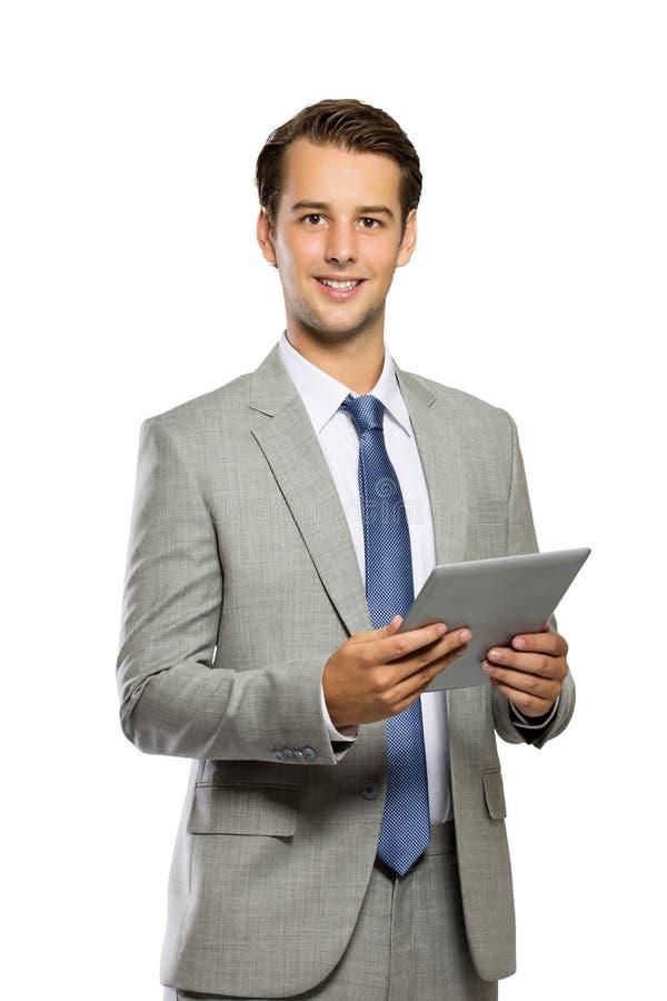 Giovane uomo d'affari con un pc della compressa, sorriso mentre stando, isolat fotografie stock