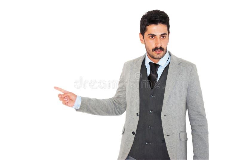 Giovane uomo d'affari dei baffi che dà presentazione di affari fotografia stock