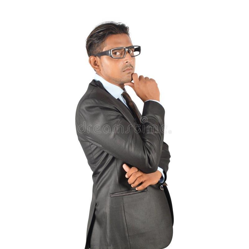 Giovane uomo d'affari nel pensiero nero del vestito immagine stock libera da diritti
