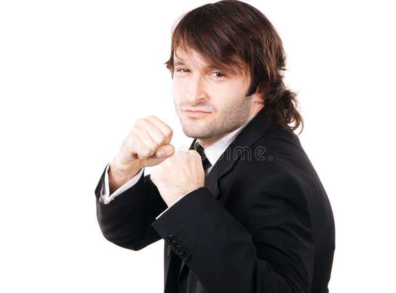 Giovane uomo d'affari nella posa di inscatolamento immagini stock
