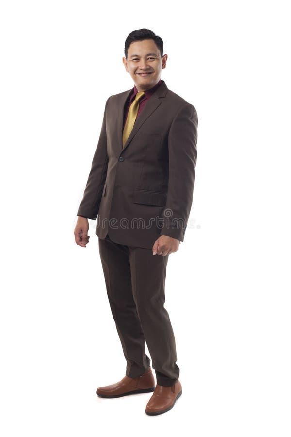 Giovane uomo d'affari Standing Straight Gesture, espressione sorridente dell'Asia immagini stock