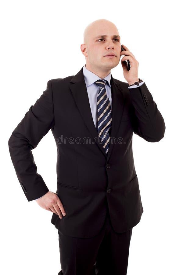 Giovane uomo d'affari su una chiamata di telefono cellulare immagini stock libere da diritti