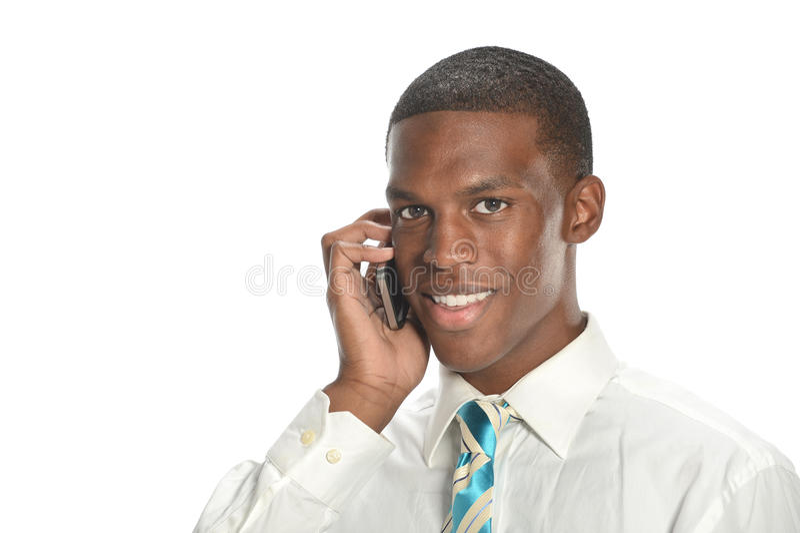 Giovane uomo d'affari sul telefono delle cellule fotografia stock