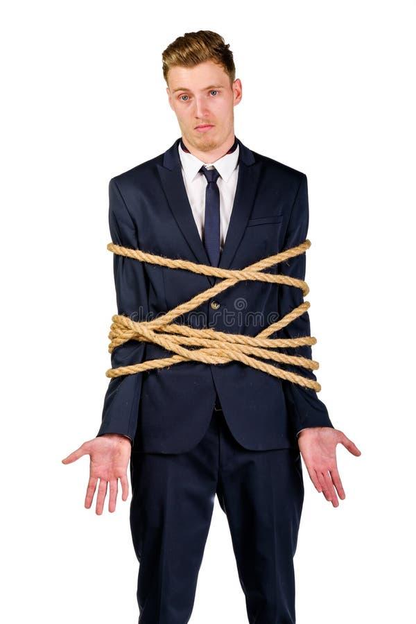 Giovane uomo d'affari in un vestito legato fotografia stock