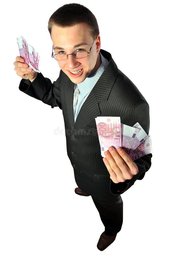 Giovane uomo d'affari in vetri che tengono gli euro immagini stock