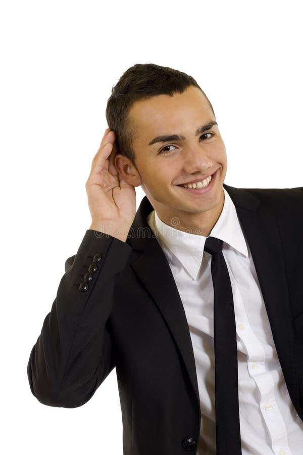 Giovane uomo di affari, ascoltante immagine stock