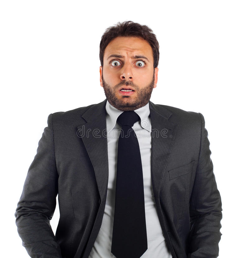 Giovane uomo di affari con un'espressione di timore immagine stock